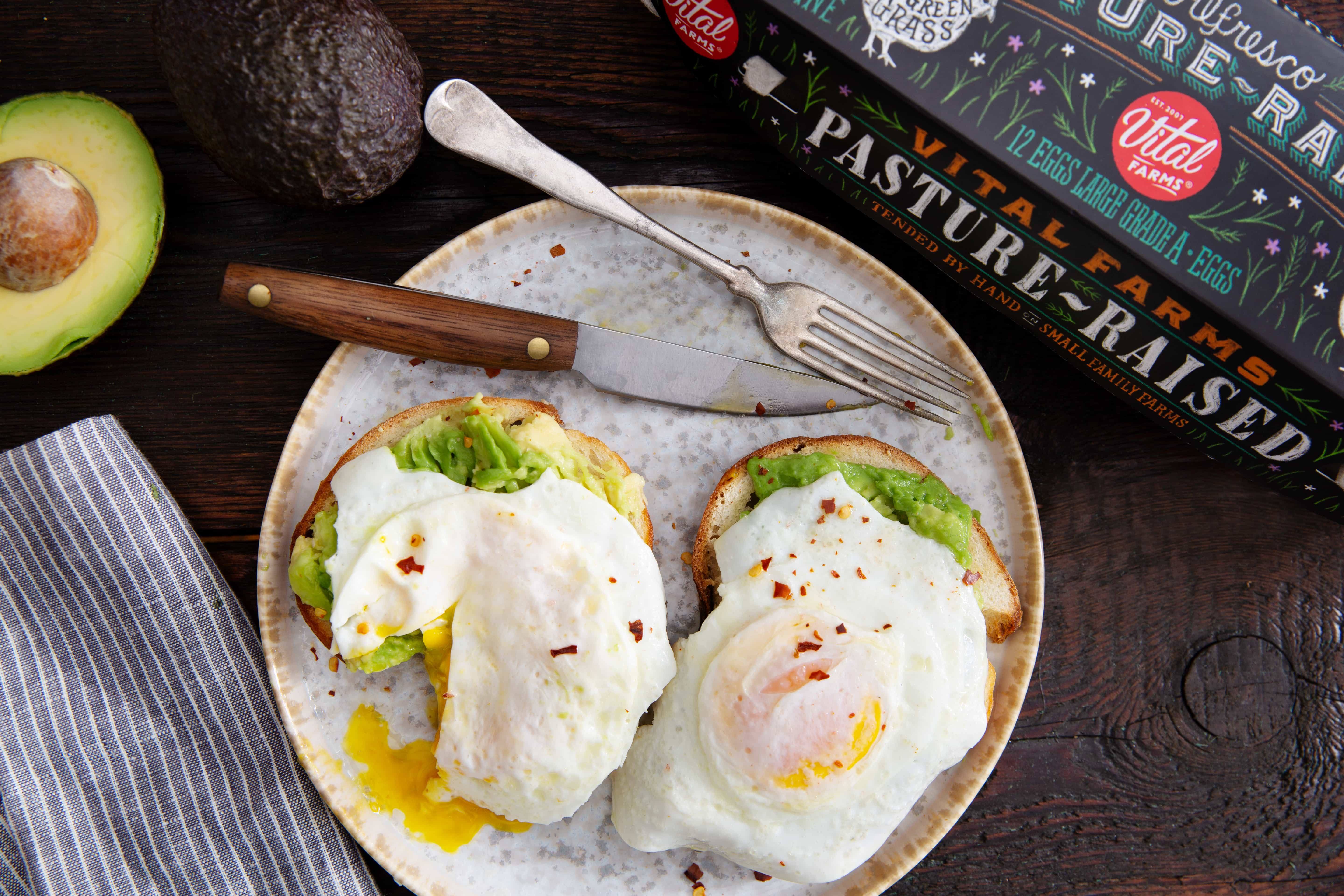 A photo of over easy eggs on avocado toast